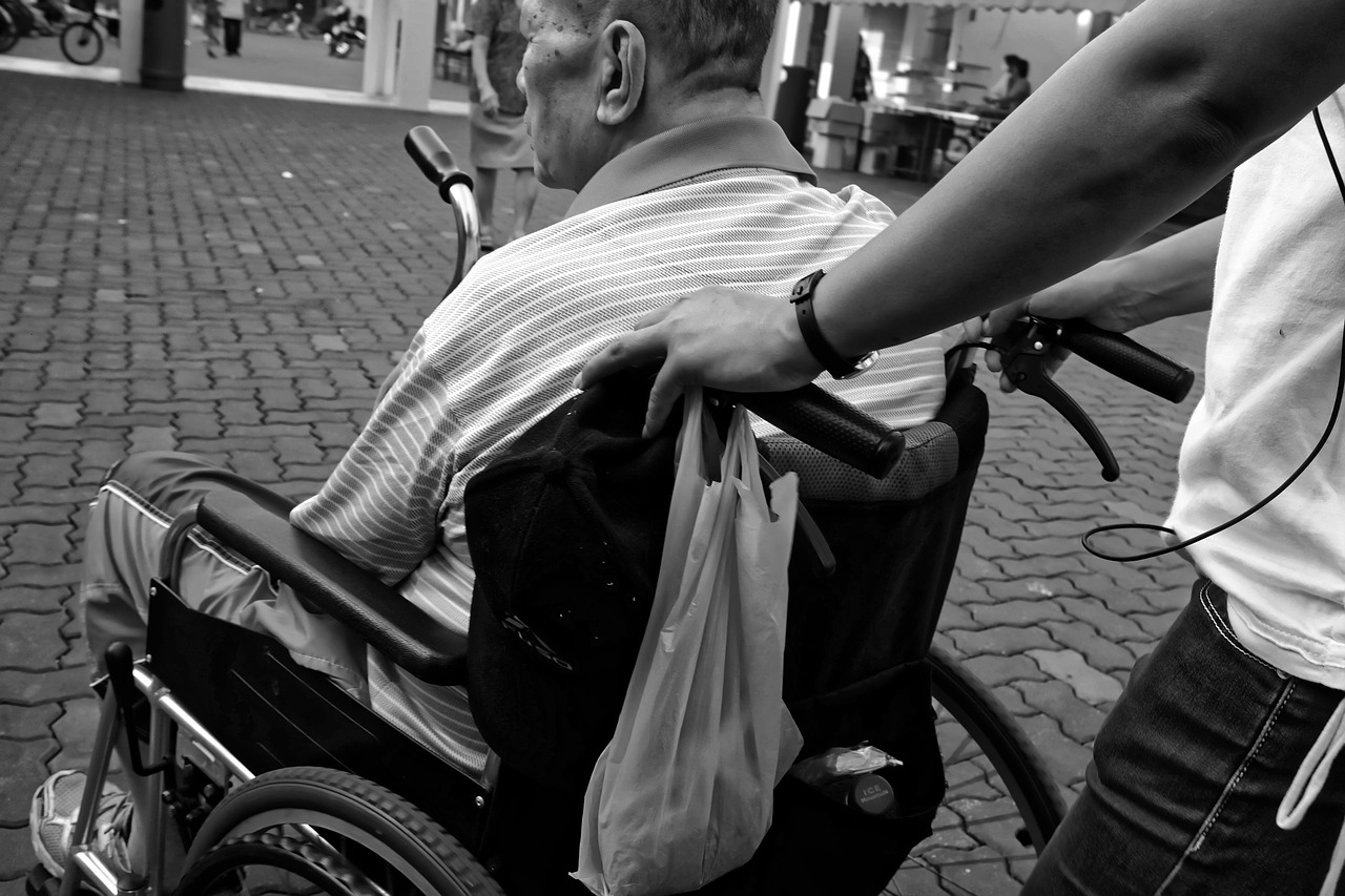 Family pushing man in wheelchair
